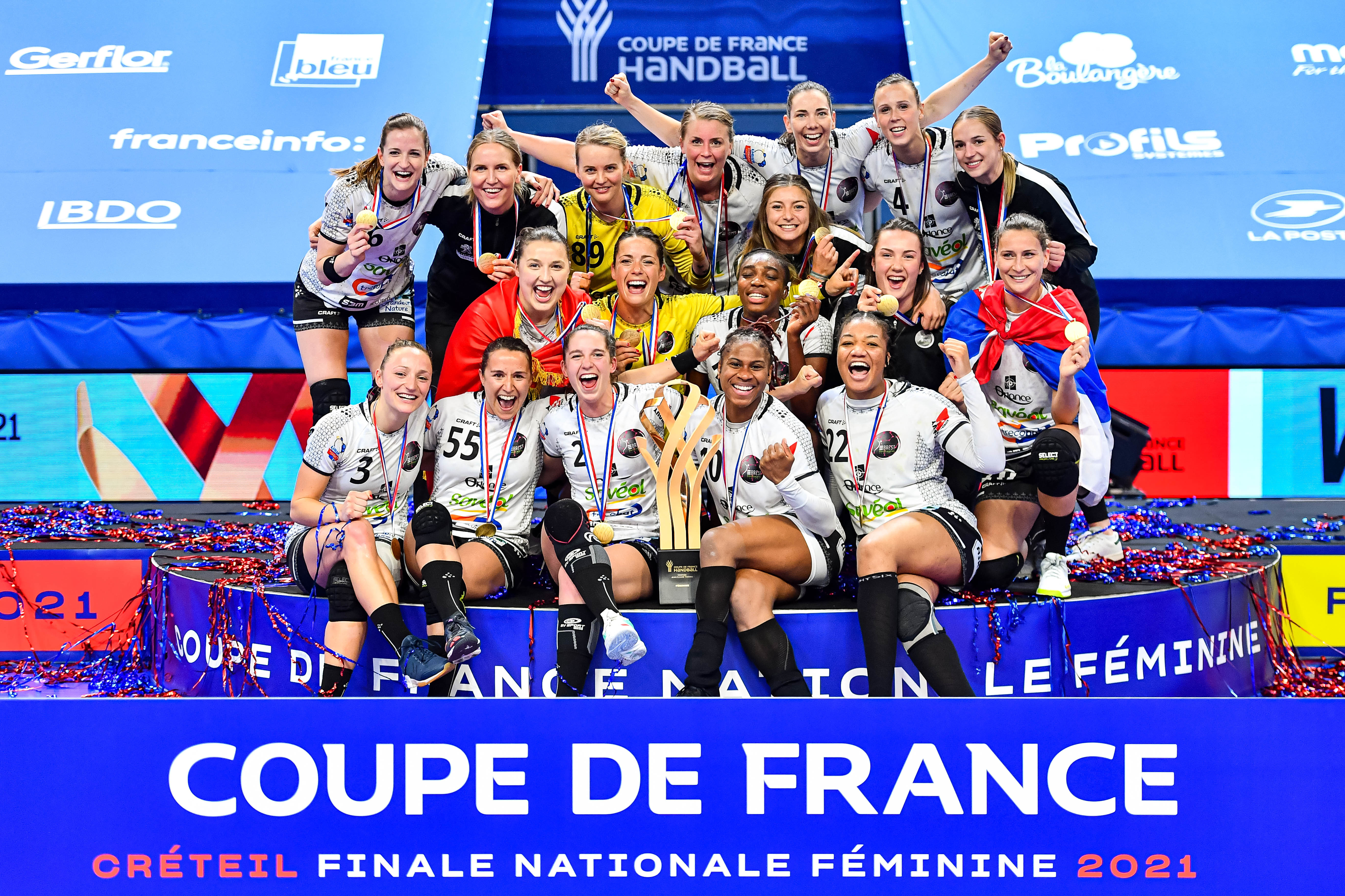 Players of Brest celebrate their victory with the trophy during the women's French Cup handball final match between Nantes and Brest on May 15, 2021 in Creteil, France. (Photo by Baptiste Fernandez/Icon Sport) - Palais des Sports Robert Oubron - Creteil (France)