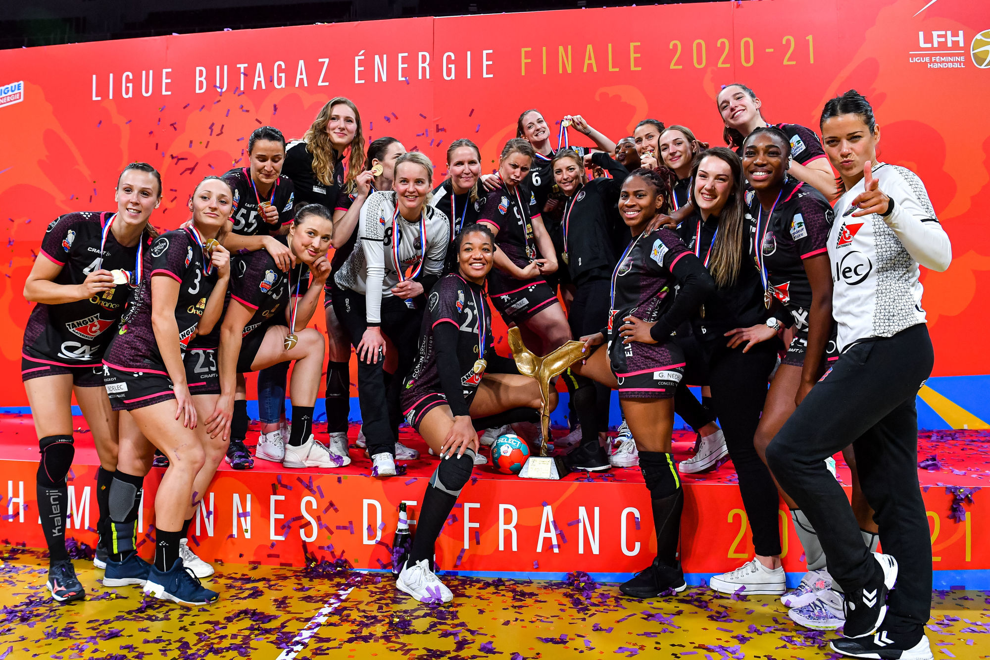 Team of Brest celebrate their victory on the podium with the trophy after the women's Ligue Butagaz Energie final match between Brest and Metz at Brest Arena on May 23, 2021 in Brest, France. (Photo by Baptiste Fernandez/Icon Sport) - --- - Brest (France)
